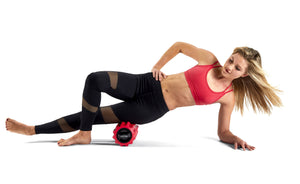 Red Phenom Vibrating Foam Roller being used on IT Band