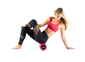 Red Phenom Vibrating Foam Roller being used on glutes