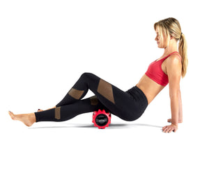 Red Phenom Vibrating foam roller being used on hamstring