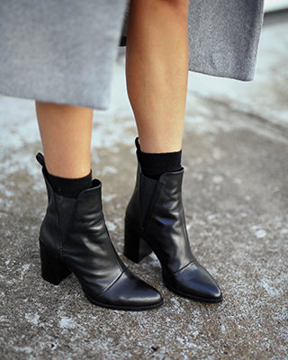 Woman modeling Honesty boots in black