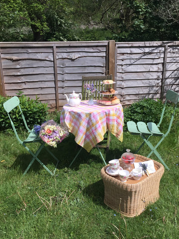 garden tea party with a wooden fence behind