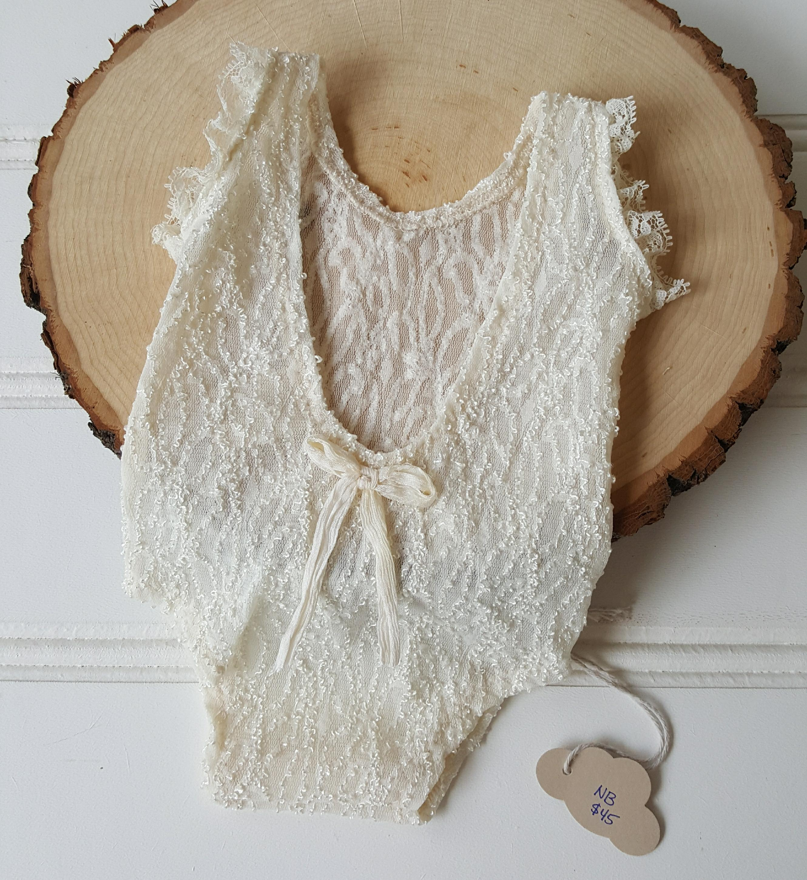 newborn ivory semi sheer textured sleeveless romper