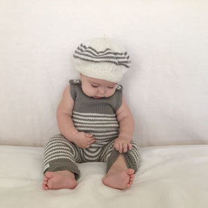 Baby wearing knitted merino wool mushroom natural stripe baby dungarees.