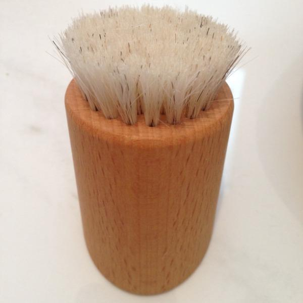 front view of natural bristle wooden face brush