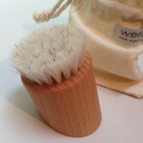 Natural bristle face brush with muslin carry bag.