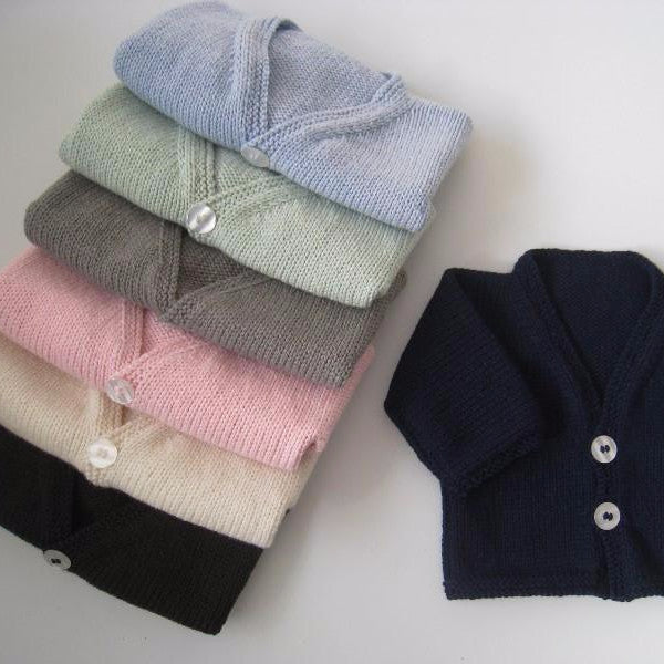 Set of baby cardigans showing colour range