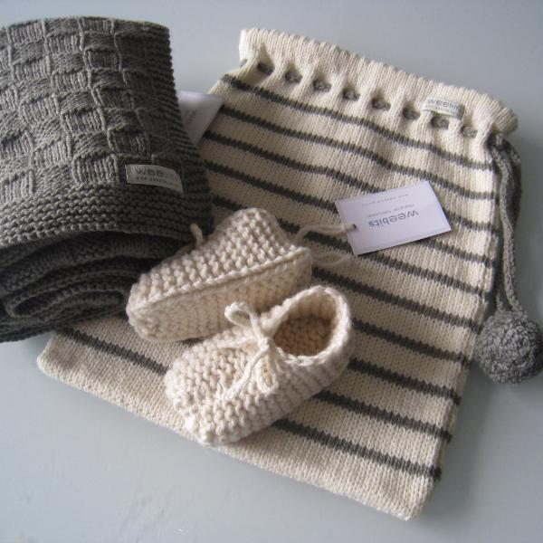 natural mushroom stripe knitted baby bag with mushroom travel rug and natural chunky booties