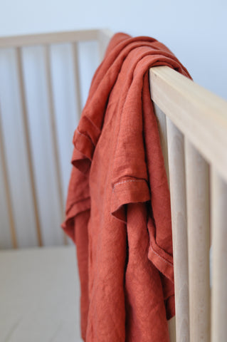 bright terracotta linen swaddle