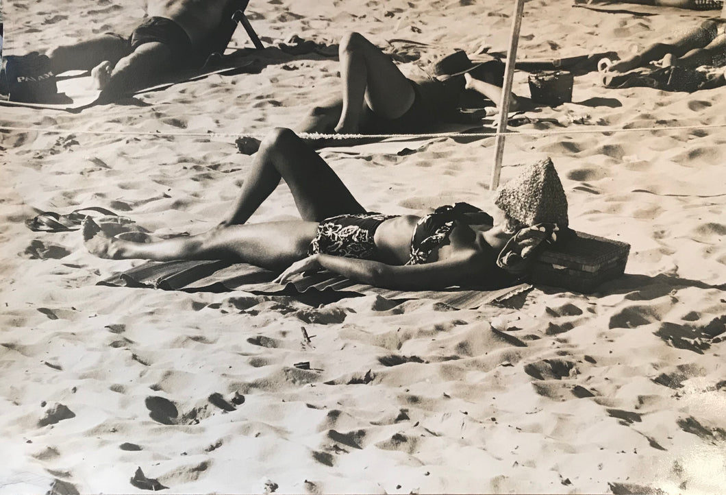1950's Vintage Photograph Of Sunbathers On Waikiki Beach