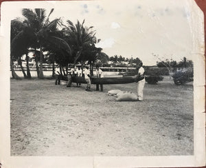 1952 Vintage Press Photograph Of A Canoe Being Carried In Hawaii