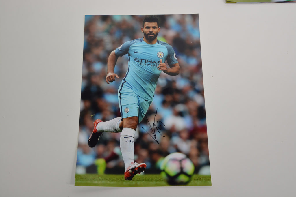 200143 - Sergio Aguero Personally Signed Photo in Manchester City kit - Treasure TV
