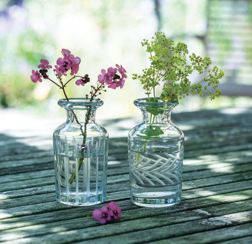 A pair of etched glass vases.