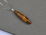 natural tiger eye shuttle pendant