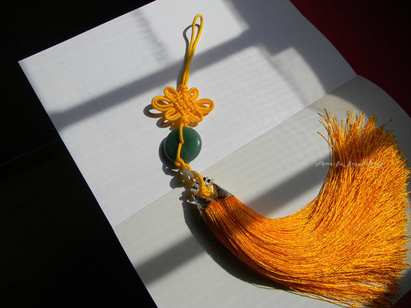 green donut orange tassel hanger