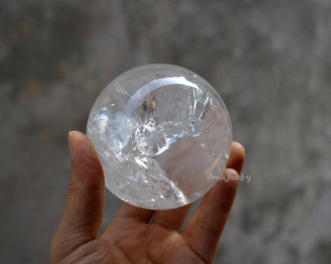 big natural clear white quartz crystal sphere
