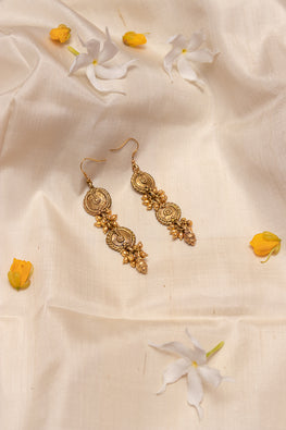Miharu Long circular dokra brass earrings