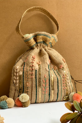 Dhaaga Handcrafts -Natural Jute Potli with lines handemboridery embellished with metal sequence beads