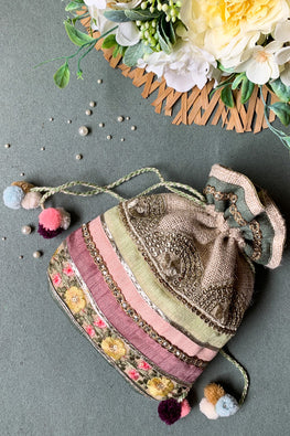 Dhaaga Handcrafts - Ivory jute potli with floral pastel laces