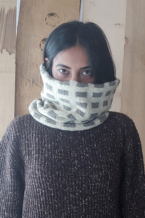 The Color Caravan Handknitted 'Hygge Unisex Fusuma Snood ' in Merino wool blended with indigenous sheep wool.