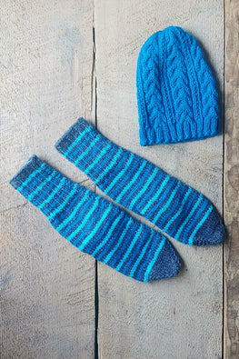 The Color Caravan Unisex 'Blue Cable Cap and Striped Socks' set in Acrylic Wool