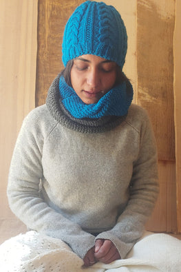 The Color Caravan Unisex 'Blue Cable Cap and Color Block Infinity Scarf' set in Acrylic Wool
