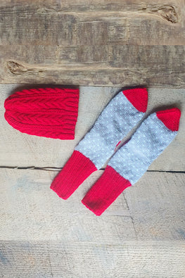 The Color Caravan Unisex 'Red Cable Cap and Hearts Socks' set in Acrylic Wool