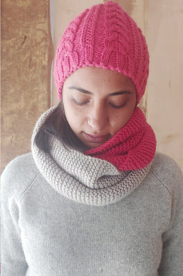 The Color Caravan Unisex 'Pink Cable Cap and Color Block Infinity Scarf' set in Acrylic Wool