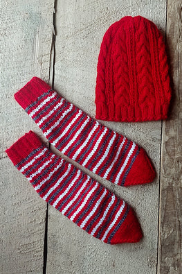 The Color Caravan Unisex 'Red Cable Cap and Striped Socks' set in Acrylic Wool