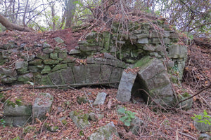 This is the remains of one of the earliest static stone kilns used from 1867 to 1891.  It was lined with fire bricks.