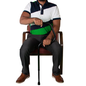 Individual Sitting in Chair Holding Easy Riser Cane