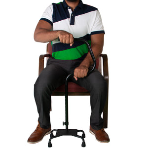 Individual Sitting in Chair Holding Easy Riser Quad Cane