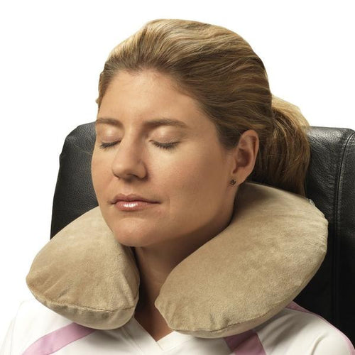 Tan Memory Foam Neck Cushion on Woman's Neck