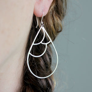 Bird wing inspired dangle earring design by Rebecca Haas