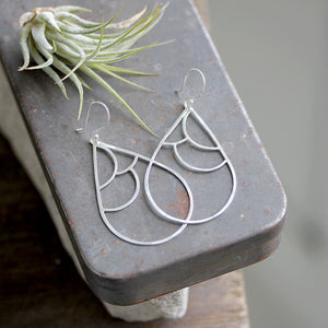 Geometric and modern wing earrings by Rebecca Haas