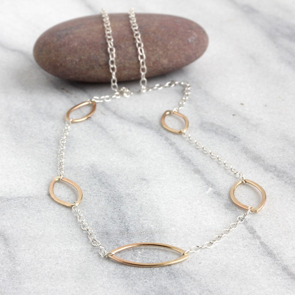 Cass Necklace: Elegant Strand With Multiple Open Ellipses and Delicate Chain