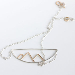 Telluride Necklace in Mixed Metal On A White Background