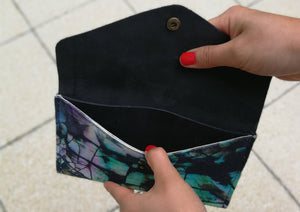 Leather travel wallet with abstract textile design