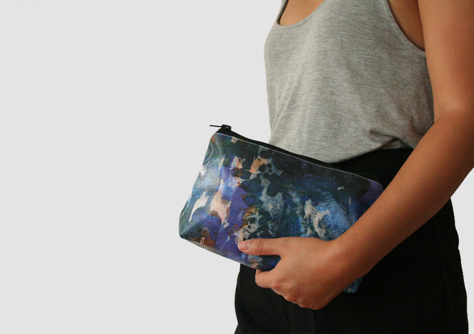 Model with blue camo printed waterproof cosmetic bag, Samantha Warren