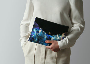 Blue leather envelope clutch bag by Samantha Warren
