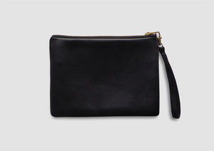 Black leather bag with wrist strap by Samantha Warren