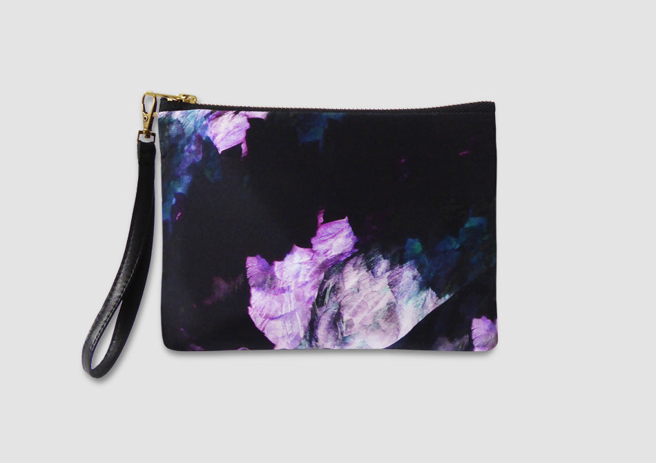 purple and black bag with feather print