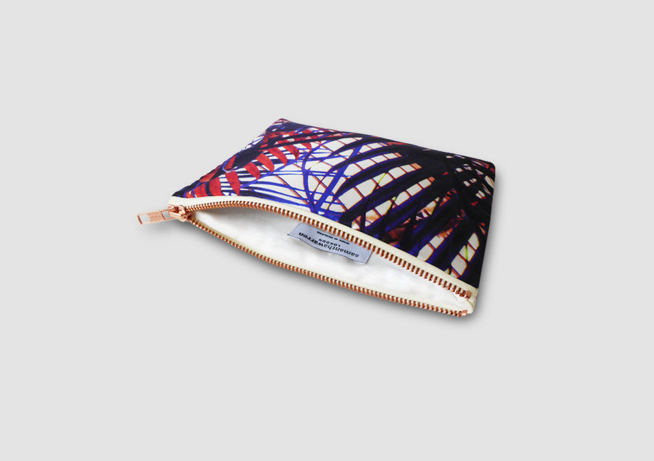 Inside clutch bag with tropical print
