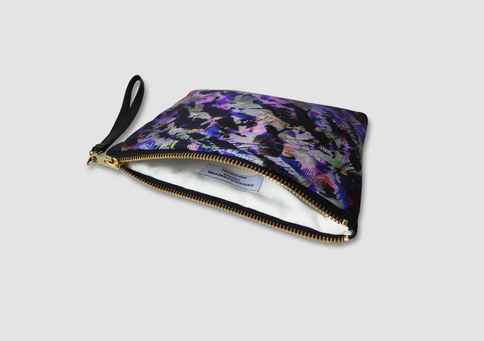 Purple and black clutch bag with wrist strap