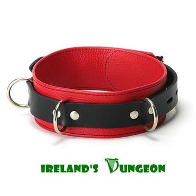 The bondage collar itself is red faux leather with black outlined stitching. The band that holds the collar around the neck is made of a high quality black leather material. The collar is 2