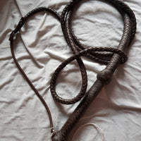 This is a long 8ft Brown Bullwhip from the bondage shop at irelandsdungeon and is brown and made from pakistani leather