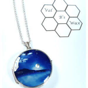 Val B's Wax Sterling Silver locket featuring blue silver mooncape