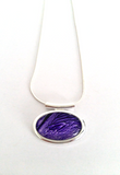 Purple small abstract tube pendant hand painted in bees wax and sealed in glass beautifully