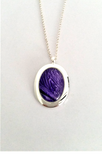 Beautiful purple oval pendant hand painted in bees wax and sealed in glass to make an amazing cabochon