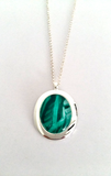 Jade oval pendant elegant and simple yet stylish hand painted on bees wax and sealed in glass to make the beautiful cabochon