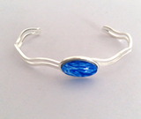 Brilliant blue fully adjustable wave bangle handpainted in wax and sealed in glass